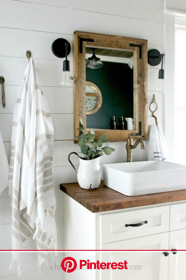 This vintage inspired farmhouse bathroom is filled with wood tones, mixed metals, … | Modern farmhouse bathroom, Farmhouse bathroom vanity, Farmhouse
